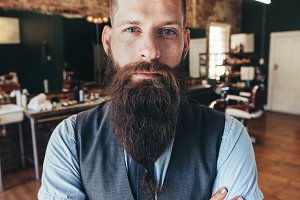 Stylish male barber with beard