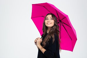 Beautiful woman holding umbrella and looking up