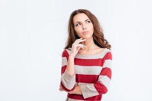 Pensive woman looking away at copyspace