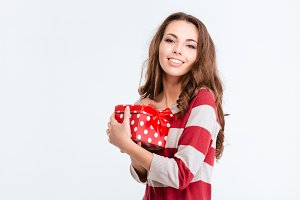 Happy lovely woman holding gift box