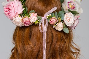 Back view of woman with long hair in flower wreath