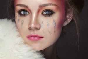 Attractive woman with colorful makeup