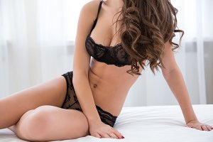 Sexy female body in black lingerie