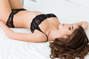 Woman lying on the bed in lingerie