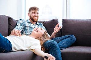 Laughing couple having fun on the sofa