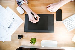 Table of graphic designer using pen tablet with stylus