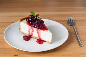 Cheesecake with sweet cherry sauce
