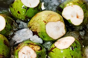 Fresh unpeeled coconuts