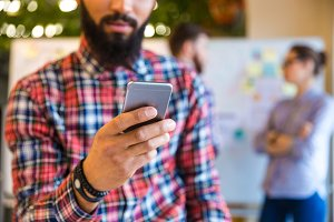 Afro american man using smartphone in office