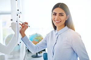 Gorgeous business woman with marker on board