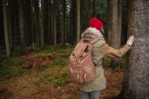 Attractive young woman walking in the forest