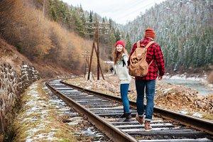Beautiful couple walking on railroad together