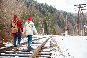 Couple walking on railway