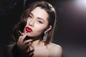 Charming woman smoking cigarette