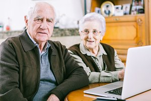 Senior couple working with Laptop