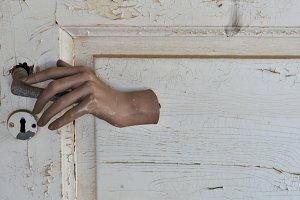 Door With Doll Hand