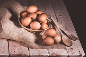 eggs with wooden cutlery basket