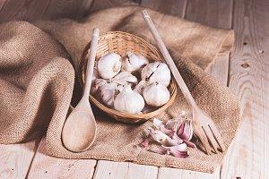 garlic with wooden cutlery basket