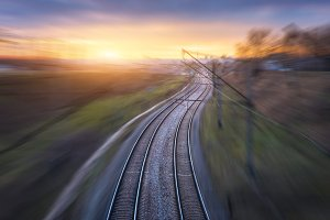 Railroad in motion at sunset
