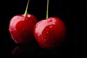 Juicy cherry isolated on black
