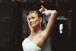 Blonde bride behind old wooden door