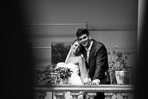 A happy wedding couple on a balcony