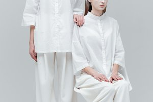 Two women in white fashion clothes