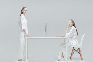 Two women using future technology