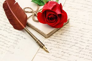 Red rose flower, old letters