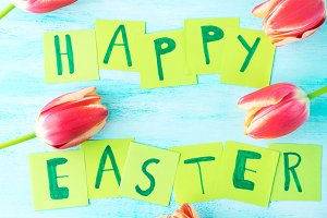 Happy Easter background tulips flowers hand written letters