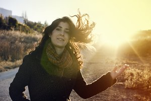 Sun flare beauty girl moving hair