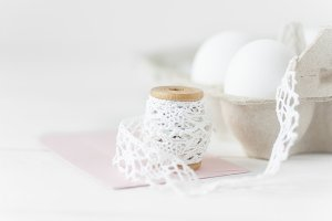 Easter eggs on white wood with pink