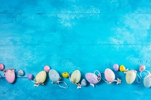 Easter eggs on bright blue
