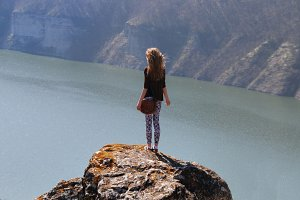 freedom girl in mountains having summer travel holidays vacation