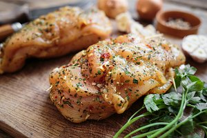 Spicy chicken breast on wooden board