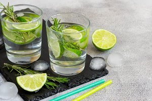 Cocktail with lime and rosemary, copy space