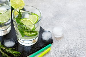 Ice Cocktail with lime and rosemary, copy space
