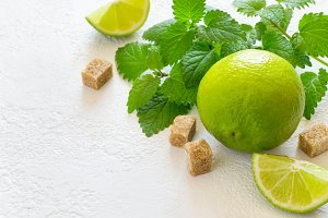 Ingredients for Mojito. Juicy lime, mint and brown sugar, copy s