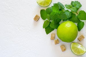 Ingredients for Mojito. Juicy lime, mint and brown sugar. Top vi