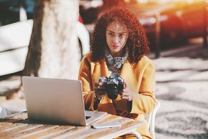 Lady with retro film camera and PC