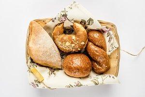 Khachapuri, bagel, wicker bun and round bun in basket
