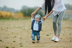 Mom with preteen child walking outdoor