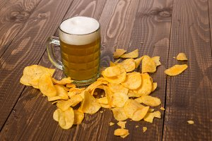 Frothy beer and chips