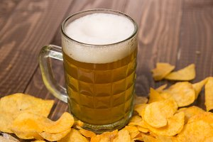 Frothy beer and crunchy chips