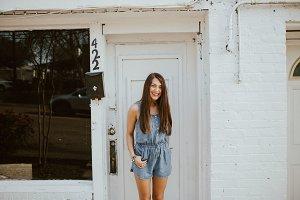 Girl Standing in Doorway
