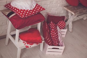 Different red and white pillows