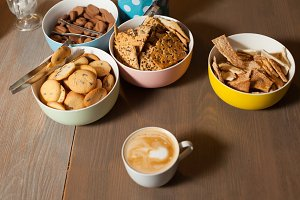 Plates with cookies and cuo on table