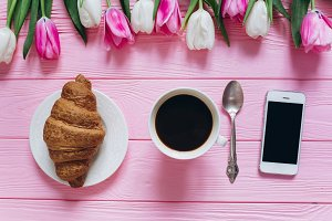 Cup of coffee with croissant.