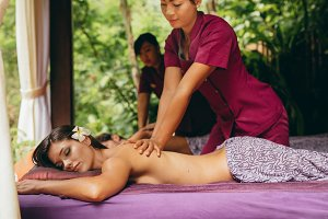 Massage therapist massaging