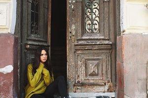 beautiful woman near the old doors